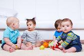 Four babies group — Stock Photo