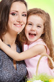 Girl embracing mother — Stock Photo