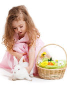 Girl playing with Easter bunny — Stock Photo