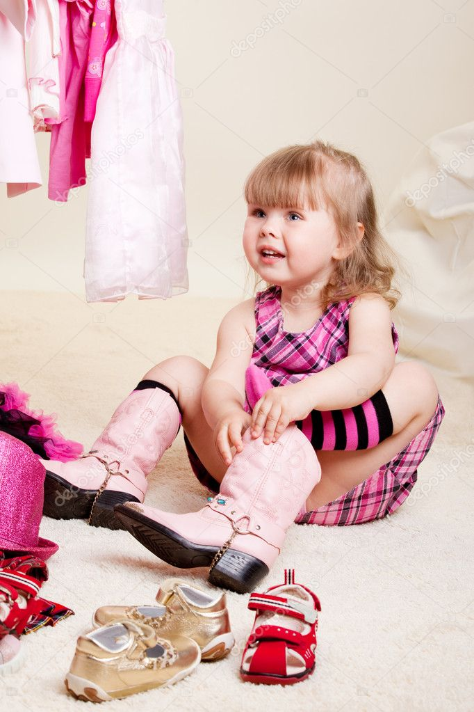 A cute fashionable girl trying on glamour boots — Stock Photo #5774662