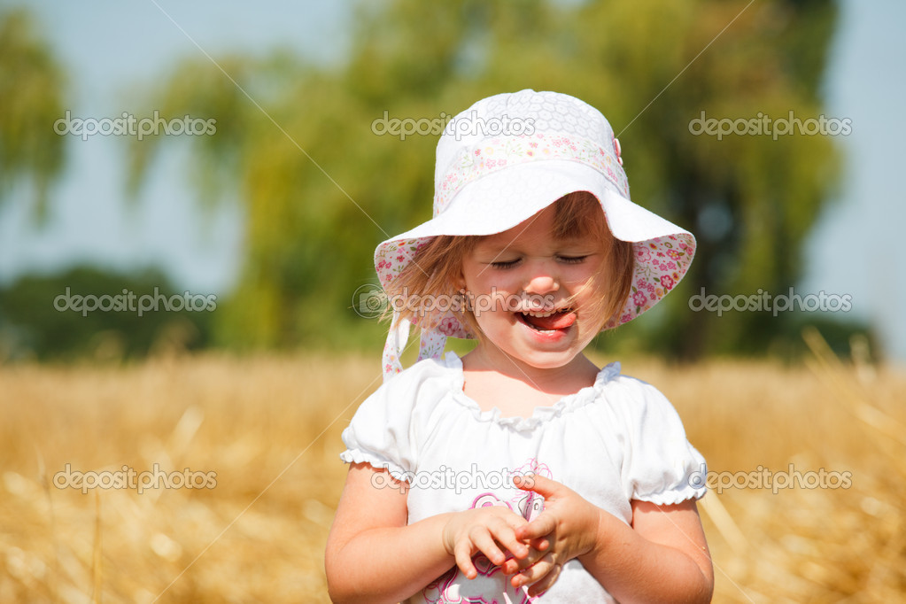 Portrait of a pleased little girl with her mouth out — Stock Photo #5775146