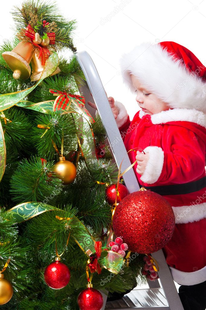 Baby decorating christmas tree stock photo anatols for Baby christmas tree decoration