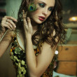 Beauty brunette in gold dress — Stock Photo