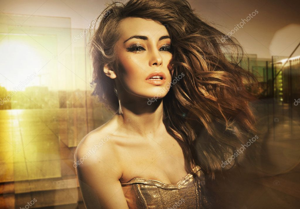 Stunning beauty posing in the sun  Stock Photo #5383212