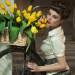 Beauty brunette with bunch of flowers - Foto Stock