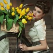 Stock Photo: Beauty brunette with bunch of flowers