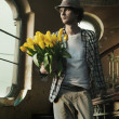 Romantic man holding bunch of tulips — Stok fotoğraf