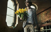 Romantic man holding bunch of tulips — Stock Photo