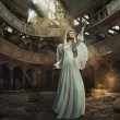 Stock Photo: Beautiful angel in old, abandon place