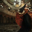 An actress in old, abandon theater — Stockfoto