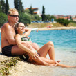 Foto Stock: Smiling couple relaxing