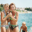 Happy family on the beach — Stock Photo #5608729