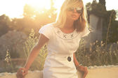 Beautiful blonde woman in sunny day — Stock Photo
