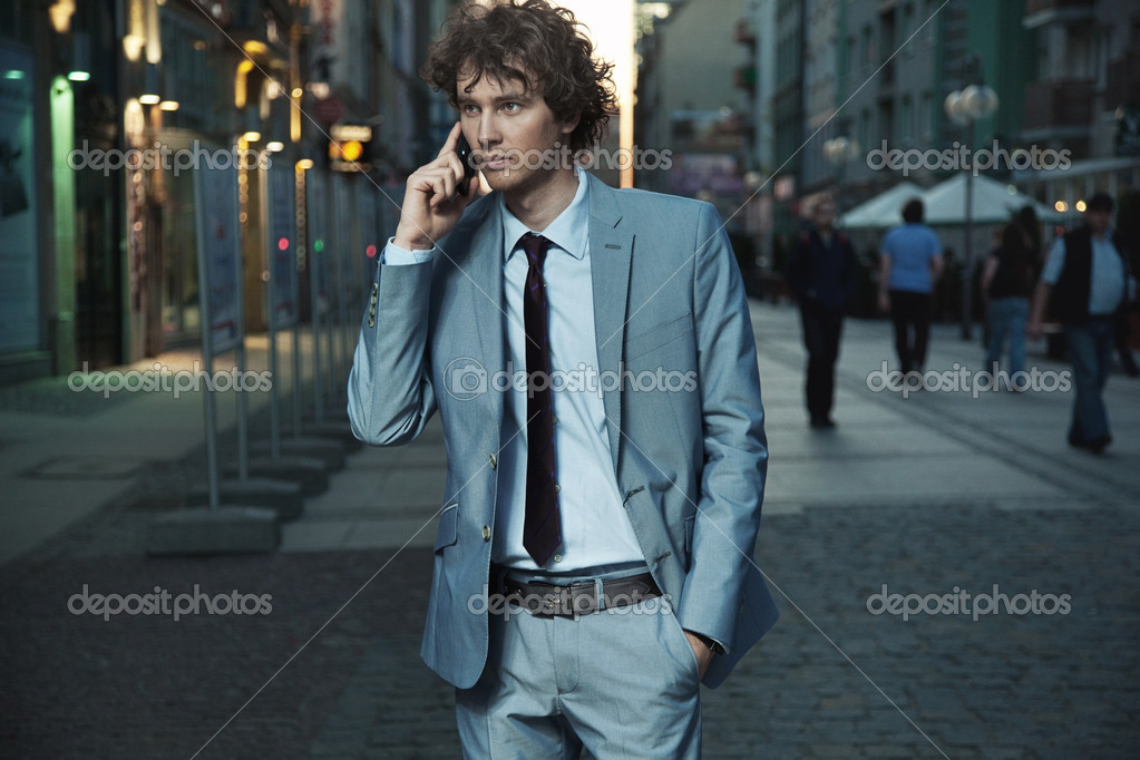 Young handsome man on evening city street — Stock Photo #5603948