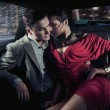 Sexy sitting couple in car — Stok fotoğraf