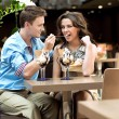 Young couple enjoying ice cream - Stock Photo