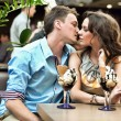 Foto Stock: Handsome couple kissing in restaurant