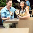 Smiling couple at the cafe — Stock Photo