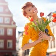 Stock Photo: Happy womwith bunch of flowers