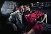 Sexy sitting couple in car — Stock fotografie