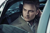 Handsome man in car — Stock Photo