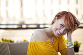 Smiling woman waiting — Stock Photo