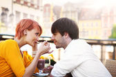 Cute young couple eating lunch — Stock Photo