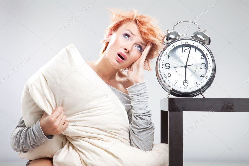 Young cute girl thinking and the clock — Stock Photo #5620668