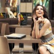 Young smiling businesswoman talking on the phone - Stock Photo