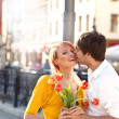 Royalty-Free Stock Photo: Handsome man kissing beautiful girl