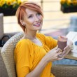 Portrait of a beautiful lady drinking afternoon coffee - Stockfoto