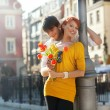 Young couple with flowers, outdoors — Stock Photo #5663199