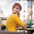 Portrait of young happy smiling woman eating lunch — Stock Photo #5663206