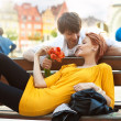 Romantic young couple relaxing outdoors smiling - Stock Photo