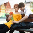 Beautiful woman with flowers on a date with handsome man — Stock Photo