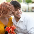 Portrait of a young cheerful couple embracing outdoors — Stock Photo