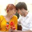 Closeup portrait of a happy young couple looking at each other - Stock Photo