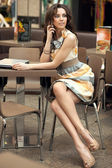 Beautiful businesswoman talking on the phone — Stock Photo