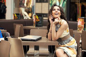 Young smiling businesswoman talking on the phone — Stock Photo