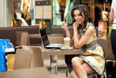 Young and beautiful business woman drinking a coffee in a pause — Stock Photo