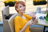 Portrait of a beautiful lady drinking afternoon coffee — Stockfoto