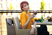 Beautiful redhead woman drinking coffe on sunny day — Stock Photo