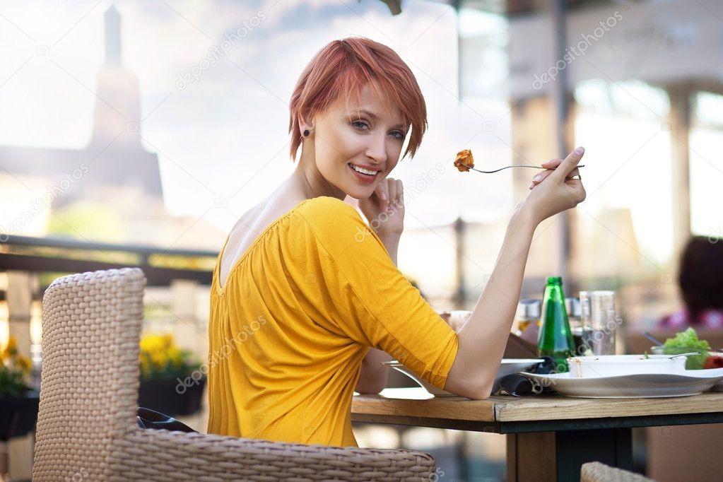 Portrait of young happy smiling woman eating lunch  Stock Photo #5663206