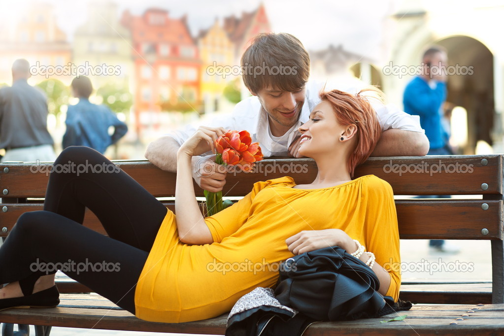 Romantic young couple relaxing outdoors smiling — Stock Photo #5663211