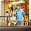 Stok fotoğraf: Young handsome couple having fun at shopping center