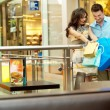 Young handsome couple walking at shopping passage — Stock Photo #5691092