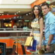 Young couple walking at shopping passage — Foto de Stock