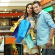 young couple in shopping center — Stock Photo