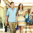 Pair of young in a shopping center — Stock Photo