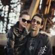 Handsome couple with sunglasses and guitar — Stock Photo